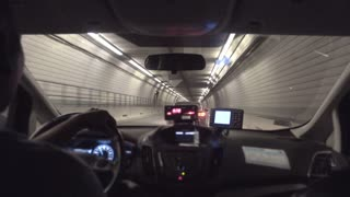 A passenger's view riding in a taxi through a tunnel under Boston.