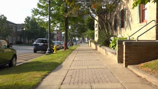A pedestrian's point of view of walking down a sidewalk in Wooster, Ohio.