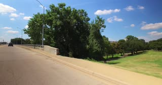 A profile view of various bridges over the Brazos River in downtown Waco, Texas.