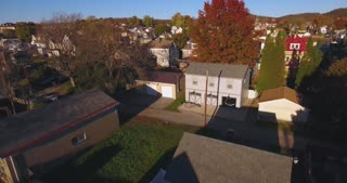 A rising aerial shot of a typical Western Pennsylvania neighborhood in the Autumn. Pittsburgh suburb.