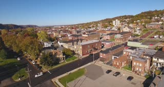 A rising aerial shot of a typical Western Pennsylvania small town in the Autumn. Pittsburgh suburb.