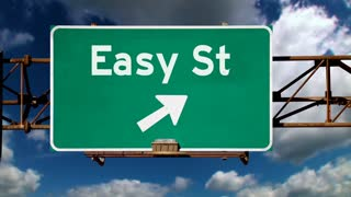 A road sign pointing to the direction of Easy Street.