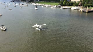 A seaplane taxis up the Allegheny River in downtown Pittsburgh, PA.