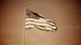 A simulated old-style film of a 13-star American flag.