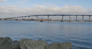 A slow dolly shot of the Coronado Bridge between downtown San Diego and Coronado Island.