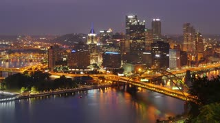 A slow zoom in of a time lapse sunrise over Pittsburgh, Pennsylvania.