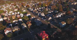 A slowly moving backwards aerial shot of a typical Western Pennsylvania neighborhood in the Autumn. Pittsburgh suburb.