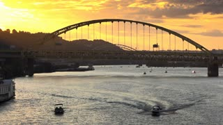A sunset over the Monongahela River and Fort Pitt Bridge in Pittsburgh, PA.