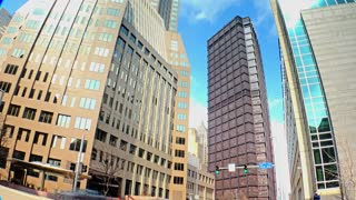 A time lapse shot of tall buildings at the corner of 5th and Ross Streets in downtown Pittsburgh, Pennsylvania.