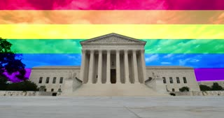 A time lapse view of the grand entrance of the Supreme Court with the rainbow flag above and behind.