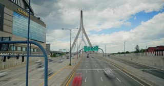 A time lapse view of traffic on the Leonard P. Zakim Bunker Hill Bridge over the Charles River in Boston.