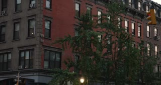 A typical Manhattan apartment building evening establishing shot.