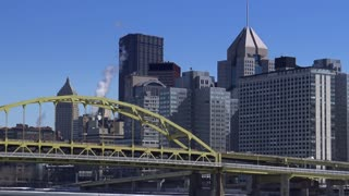 A winter establishing shot of Pittsburgh, PA.  Large, corporate logos on the buildings have been removed for general use.