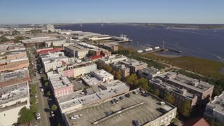 An aerial establishing shot of Charleston, South Carolina as GPS waypoint markers animate over random buildings.