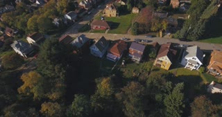An aerial view above a small Western Pennsylvania town and residential neighborhood on an Autumn evening.