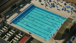 An aerial view of people swimming.