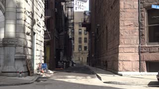 An empty alley in a big city.