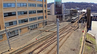 An establishing shot of a subway train leaving the First Avenue T station in downtown Pittsburgh.