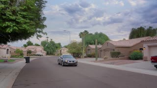 An establishing shot of a typical Arizona-style residential neighborhood.