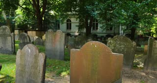 An establishing shot of headstones in King's Chapel Cemetery in Boston.