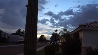 An establishing shot of sunset over a typical Arizona-style residential neighborhood.