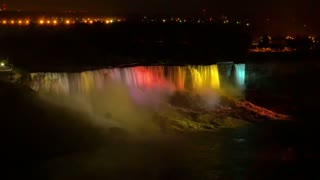An establishing shot of the American Falls at night.