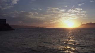 An establishing shot of the Golden Gate Bridge at sunset.