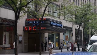 An establishing shot of the NBC Studios entrance in Rockefeller Center.