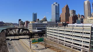 An establishing shot of the Pittsburgh city skyline during the day in early Spring.