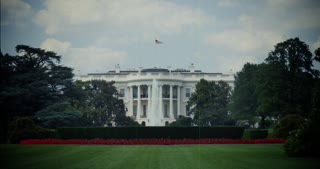 An establishing shot of the White House.  Modern video artificially aged to look like archival film footage.