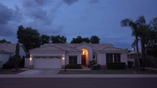 An evening establishing shot of a typical Arizona-style home near Phoenix.