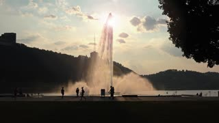 An evening establishing shot of the fountain at Point State Park in Pittsburgh.