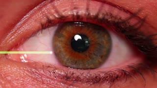 An eyeball with an EKG wave.
