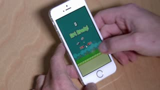 An unidentified user plays the popular Flappy Bird game on an iPhone 5S. For editorial use only.