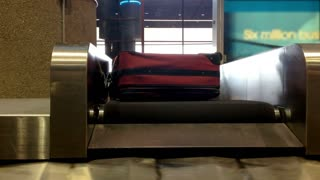Baggage Claim as Bags Fall on Belt
