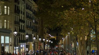 BARCELONA, CATALONIA, SPAIN - Circa October, 2014 - People walk the popular and crowded streets and sidewalks of Barcelona's Gothic District at night.
