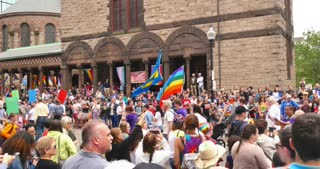 BOSTON, MA - Circa June, 2016 - Spectators enjoy the Gay Pride Parade as it passes the Trinity Episcopal Church on Clarendon Street in downtown Boston.