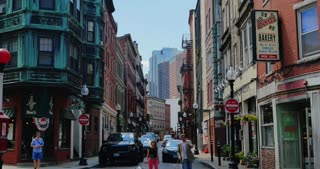 BOSTON, MA - Circa June, 2016 - Tourists visit the various businesses and restaurants on the corner of Prince and Salem Streets in historical downtown Boston.