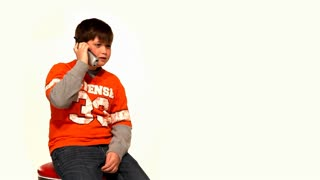 Young Boy Talks on Telephone