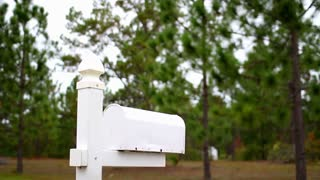 Man Checks Mailbox at Home Outside is Upset