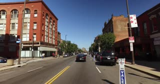 CLEVELAND - Circa, September, 2016 - Driver's perspective driving past the restaurants and businesses on the popular West 25th Street in Cleveland, Ohio.