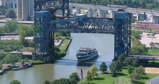 CLEVELAND - Circa September, 2016 - The tour boat, Goodtime III carries tourists on the Cuyahoga River under the Carter Road Drawbridge.