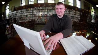 Confident Student Working Studying in College Library Thumbs Up