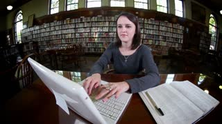 Confident Student Working Studying in College Library