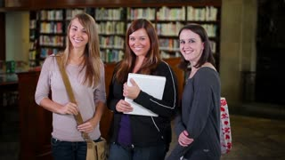 Confident Young Female Students Smile to Camera