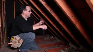 Contractor Measures Rafters Attic