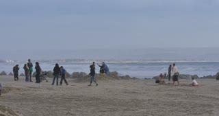 CORONADO BEACH, CA - Circa February, 2017 - Tourists play on Coronado Beach in San Diego on an overcast winter's day.