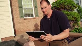Couple Uses Tablet PC Outside