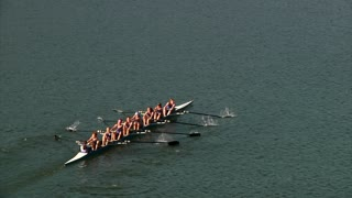 Crew Team Rows in Unison on River