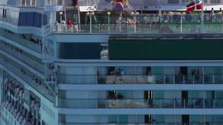 Passengers on a Passing Cruise Ship